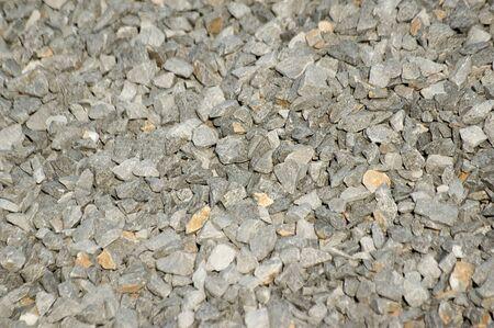 Closeup of crushed limestone gravel. Shallow depth of field. Roadways, railroads and construction concepts Reklamní fotografie