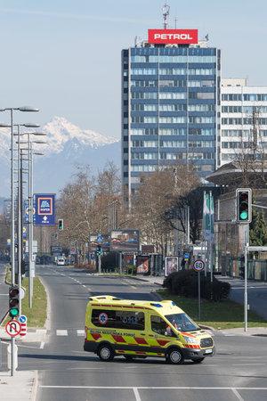 Ljubljana, Slovenia - March 17, 2020: Emergency vehicle on empty Dunajska street in downtown Ljubljana, Slovenia during the Coronavirus Covid-19 worldwide pandemic