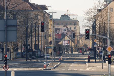 Ljubljana, Slovenia - March 17, 2020: Nearly empty streets in downtown Ljubljana, Slovenia with few people during the Coronavirus Covid-19 outbreak