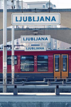 Ljubljana, Slovenia - March 17, 2020: Empty train station with vacant benches on the platform in Ljubljana, Slovenia during the Coronavirus Covid-19 outbreak