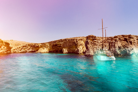 Malta Blue Lagoon and mountainous coast beauty water and boat