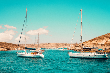 Malta Blue Lagoon and mountainous coast beauty water and boats Stock Photo