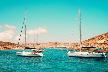Malta Blue Lagoon and mountainous coast beauty water and boats Stock Photo