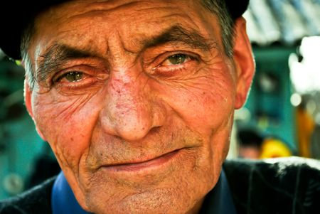 Portrait of an old man with teary eyes,  photo