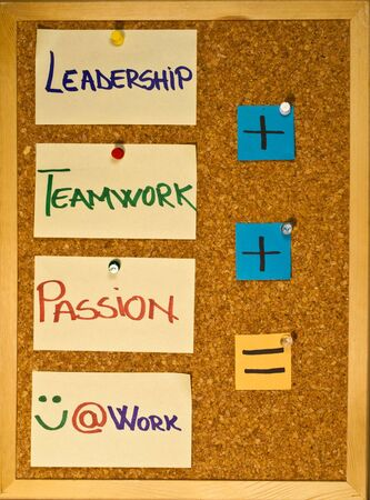 Post it notes on a wooden board representing three ingredients for happiness at work Stock Photo - 8246530