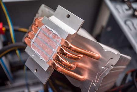 replacement of thermal paste on the processor radiator copper. computer repair and PC improvement. components for the personal computer. computer system upgrade. Uzhhorod. Ukraine - June 22. 2020 Editorial