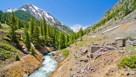 san juan: A Mountain Stream and an old silver mine in Animas Forks, a Ghost Town in the San Juan Mountains of Colorado