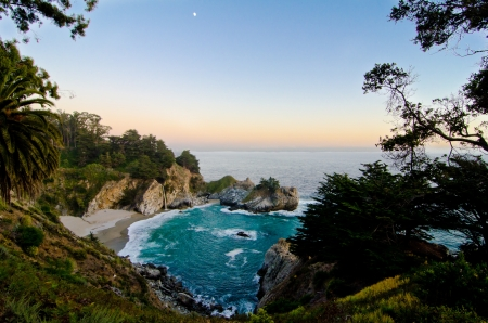 california beach: McWay Falls at Julia Pfeiffer State Park on the California coast is one of only a few waterfalls that empty directly into the ocean  Stock Photo