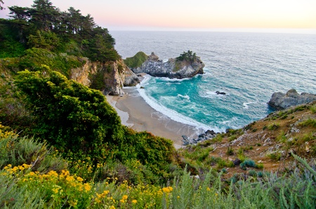 mile: McWay Falls at Julia Pfeiffer State Park on the California coast is one of only a few waterfalls that empty directly into the ocean  Stock Photo