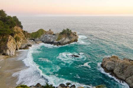 mcway: McWay Falls at Julia Pfeiffer State Park on the California coast is one of only a few waterfalls that empty directly into the ocean  Stock Photo