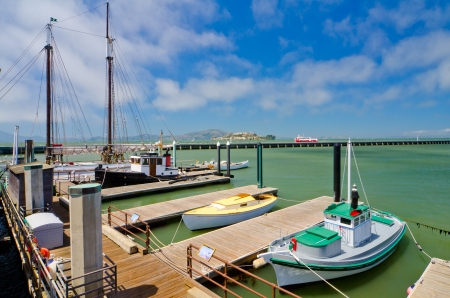 west coast: Boats docked at Fisherman s Wharf with Alcatraz in the background Stock Photo