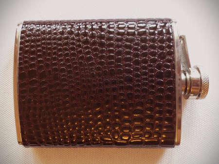 Stainless steel flask covered with natural leather.