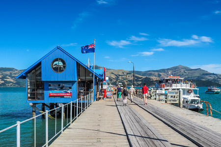 Akaroa, New Zealand - Jan 14, 2018: the tourists are joining the cruise tour at Main Wharf.