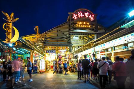 Taipei / Taiwan - Jul 5, 2018: Tourists are shopping in Shilin Night Market. Editorial