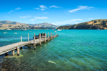 The wooden wharf at Akaroa Harbour in New Zealand.