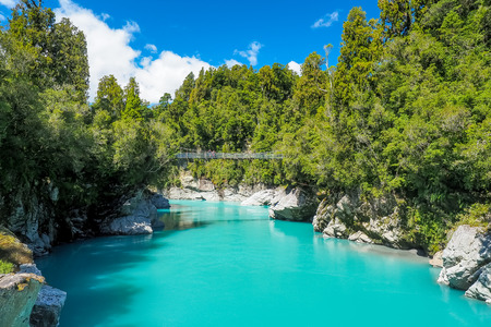 The swing bridge is on the stunning turquoise blue river at Hokitika Gorge in the South Island of New Zealand.