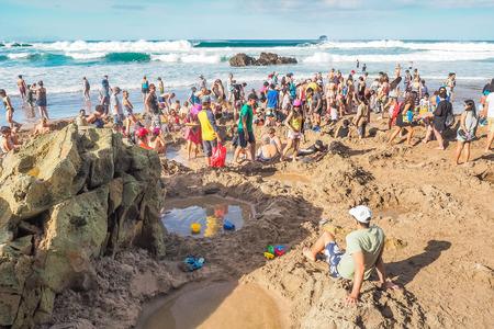 Coromandel Peninsula, New Zealand - Mar 15, 2018: Tourists are enjoying the hot springs at Hot Water Beach.
