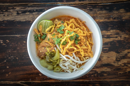 Curry noodle soup, Khao Soy, a traditional dish in Chiang Mai, Northern Thailand.
