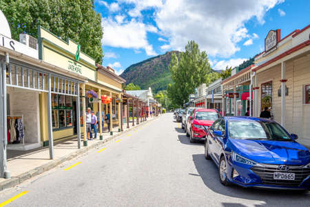 Arrowtown, New Zealand-Feb 6, 2020: Tourists are shopping around the main street in the afternoon in the autumn season.