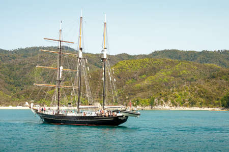 Kaiteriteri, New Zealand - Feb 2, 2020: The sail training ship, SPIRIT OF NEW ZEALAND, is sailing on Tasman Bay in Abel Tasman National Park.
