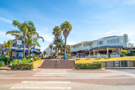 Auckland, New Zealand - Feb 14, 2020: The Oneroa Village close to Oneroa Beach is known as the capital city of Waiheki Island.