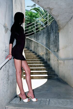 Beautiful model standing in mini skirt and heals Stock Photo - 5304597