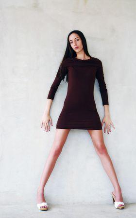 Beautiful model standing in mini skirt and heals photo