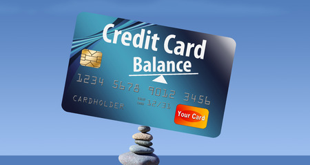 Credit card balances are represented with credit card balanced on rocks on the beach. This is an illustration. Stock fotó