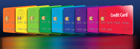 Here are generic credit cards in a spectrum of colors. The cards are lined up to create a rainbow of color. This is an illustration.