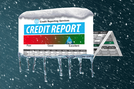 Ice and snow cover a mock credit report in this illustration about a freeze on your credit. A credit freeze is the focus of this illustration. Imagens - 110316265