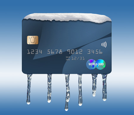 Ice and snow cover a mock credit card in this illustration about a freeze on your credit. A credit freeze is the focus of this illustration.