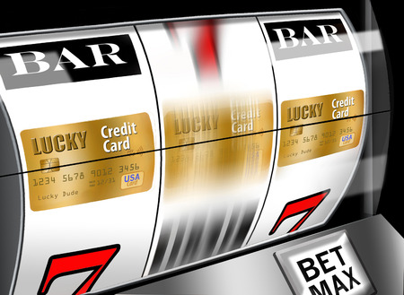 Do your research when looking for a credit card. Dont leave it to chance as illustrated with these credit cards revolving on a casino slot machine. Stok Fotoğraf