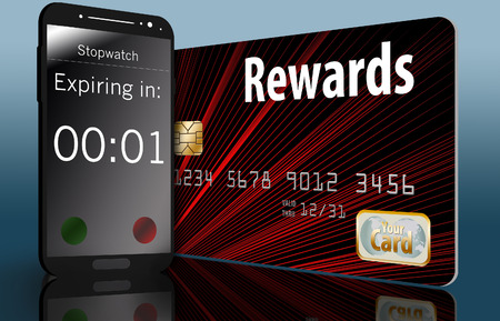 A rewards credit card is seen next to a timer running on a cell phone to illustrate that credit card rewards have an expiration date...expiring rewards.