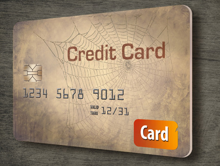What should you do with old credit card accounts? Closing a credit card can lower your credit score. Here is an illustration about that topic showing a very old card. Foto de archivo - 110208003