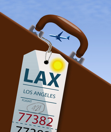An airline luggage tag hangs from a suitcase or briefcase as an airliner flies high above in the background. This travel tag is for LAX which is Los Angles. 写真素材 - 112190005
