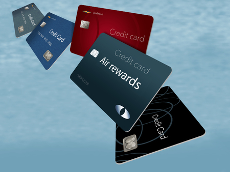 Air rewards credit cards are seen here floating and flying in the sky with airplanes in the background. This is an illustration.