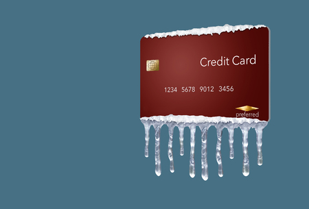 A credit freeze, or freeze on your credit report is represented with icicles and snow on a mock credit card isolated on the background. It is an illustration.