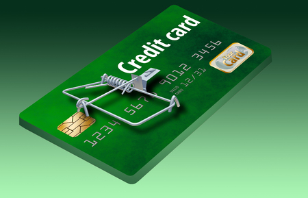 A credit card that looks like a mousetrap is seen here to illustrate the idea of credit traps, bad deals on credit cards that keep you paying. Standard-Bild - 112486104