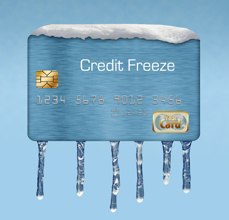 A credit card with snow and icicles illustrates the idea of a credit freeze on your credit report.