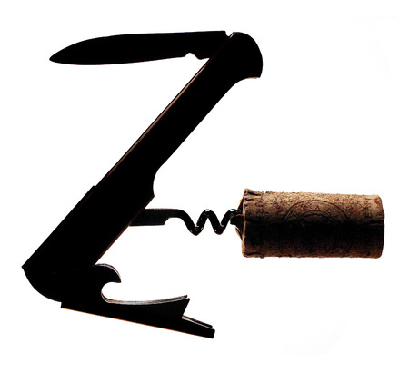 A waiter's wine tool is seen in silhouette with a cork still on the screw. Isolated on a white background.