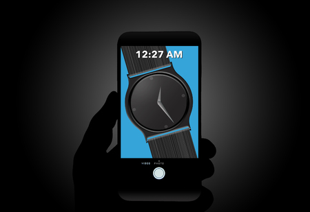 Watch vs. Cell phone is the theme of this illustration of a wristwatch seen on a cell phone screen. Precise time on mobile phone has made watches less important to own. This is an illustration.