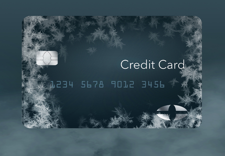 Frost covered credit cards illustrate putting a credit freeze on a credit report. This is an illustration.