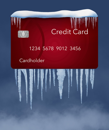 A credit freeze, or freeze on your credit report is represented with icicles and snow on a mock credit card solated on the background. It is an illustration. Imagens