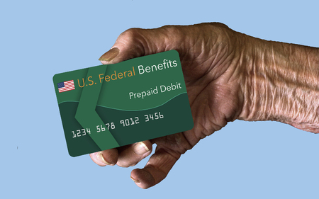 Elderly citizens can receive federal benefits in the form of a debit card. Federal  benefits for Social Security, SSI, VA  and more can be paid using a prepaid debit card. Here is a mock prepaid government debit card in an elderly womans hand.