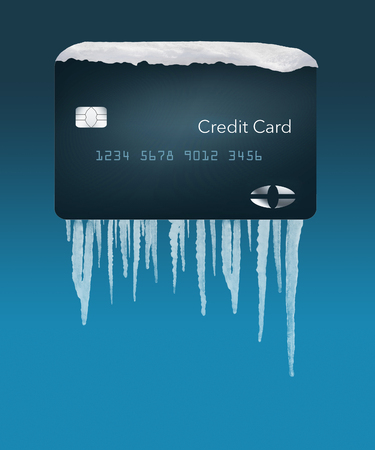 A credit card with snow on top and icicles below illustrates the idea of a credit freeze on a credit bureau account. This is an illustration.