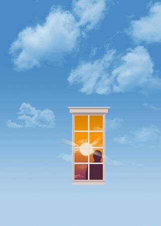HEAVENLY WINDOW- A man's silhouette is seen through a window in the sky. The sky is blue and inside the window is a man and a sunset.