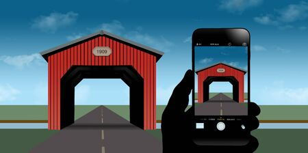 Recording history is the theme of this illustration showing a red covered bridge with a hand holding a cell phone that displays a photograph of the bridge taken on the phone.