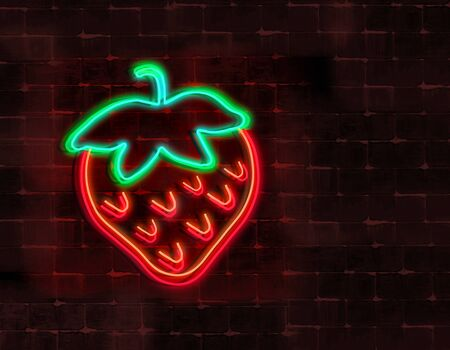 A neon light strawberry is seen glowing in the night and attached to a brick wall.