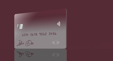 A red and grey credit card or debit card that is generic is seen reflected in a tabletop. Stockfoto