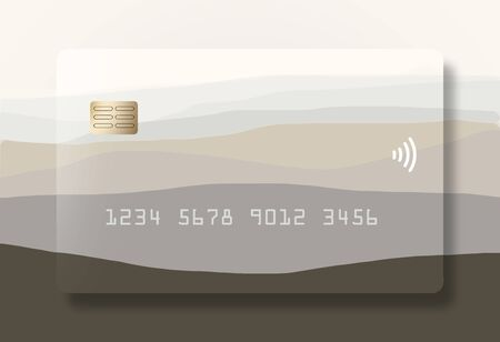 A credit card or debit card that is generic  has fading hills design and is seen on a correspondingly designed background.